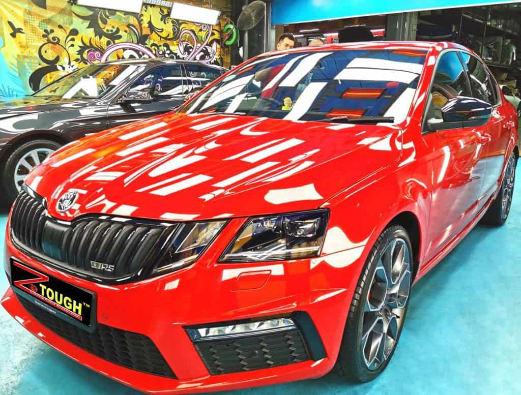 Red Skoda Octavia with its New Ceramic Paint Protection